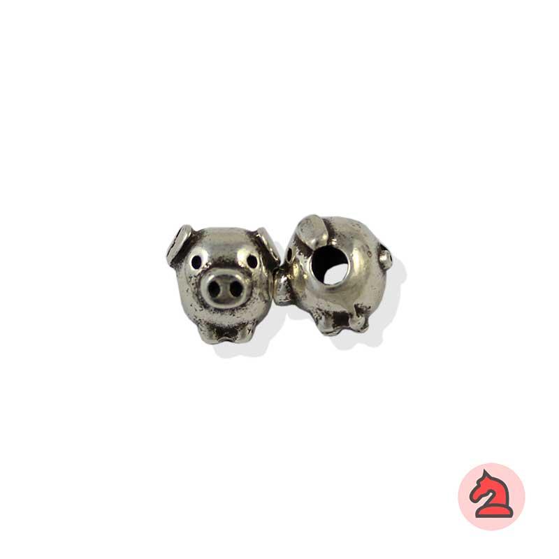 Charm cerdito para enfilar - Bolsa de 20udsTamaño aproximado 10 mm, agujero para cordón 3 mm