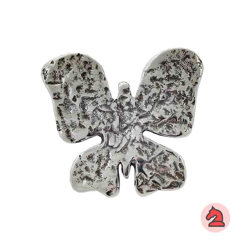 Colgante mariposa martillado 57x52 mm. Anilla de 4mm - Venta en bolsa de 10 uds