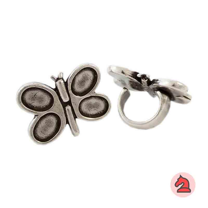 Anillo ajustable mariposa - Bolsa de 6  uds. 4 muescas de 18X13 mm Anillo de peltre con baño plata, disponible en 3 tallas. Anillo Ajustable