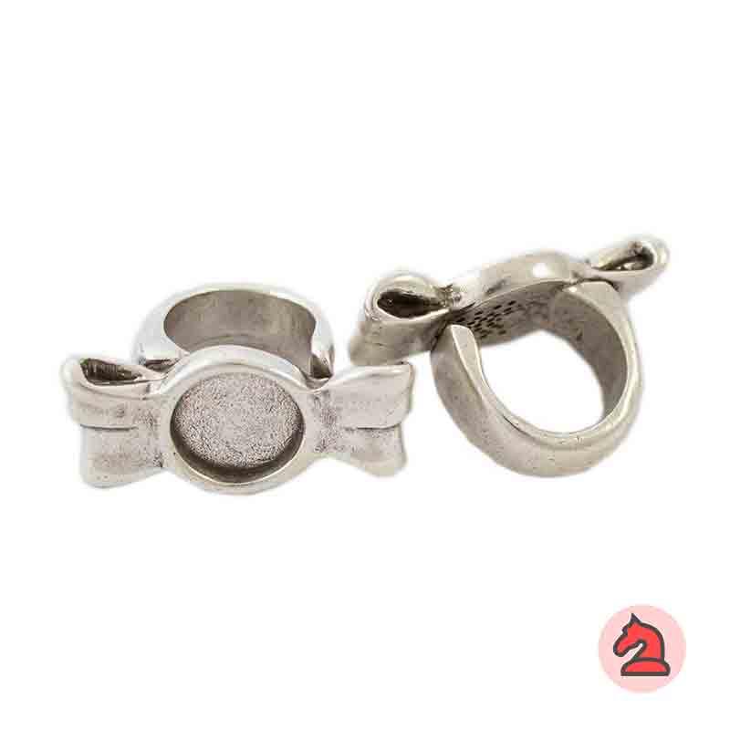 Anillo ajustable lazo - Bolsa de 6  uds. Anillo de peltre con baño plata, disponible en 3 tallas. Anillo AjustableDebes seleccionar la talla*